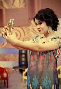 Smart-phoe in Tajik girls hand